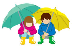 Crouching two Children  have an Umbrella,Isolated Stock Photo