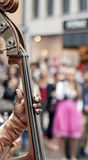 Croud of people hearing a Cello player.  Stock Photography