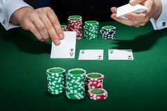 Croupier arranging cards Stock Photography