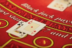 The croupier in the casino does a shuffle of cards royalty free stock images