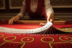 The croupier in the casino does a shuffle of cards royalty free stock photo