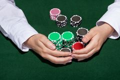 Croupier collecting in the bets Stock Photo