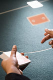 Croupier dealing cards, close-up of hands Stock Photography