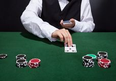 Croupier dealing cards Royalty Free Stock Photos