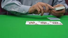 Croupier distributes cards stock video footage