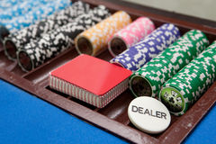 Croupier place. Casiono chips and palying cards royalty free stock photo