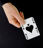 Croupier player holding card ace of spades Royalty Free Stock Photos