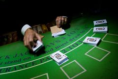 Croupier preparing decks of cards. Casino dealer preparing stacks of cards for a night of blackjack dealing royalty free stock images
