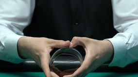Croupier professionally shuffles cards and gets ace, card trick bluff, closeup. Stock footage stock footage