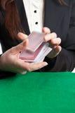 Croupier shuffling cards stock image