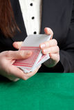 Croupier shuffling cards Stock Image