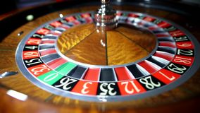 Croupier is spinning the ball on Roulette stock video footage