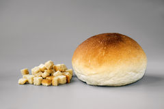 CROUTON AND BREAD ROLL. Isolated on Grey Royalty Free Stock Image
