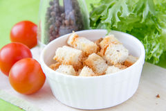 Crouton in white ceramic cup Stock Photo