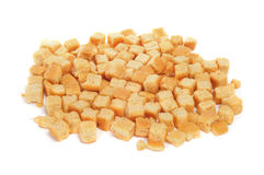 Croutons. A pile of croutons on a white background royalty free stock image