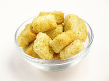 Croutons. Crispy cubes of seasoned croutons in a bowl royalty free stock image