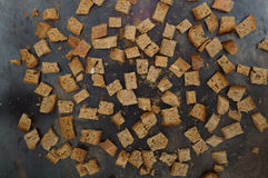 The croutons on the baking sheet Stock Photo