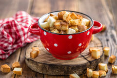 Croutons. In a bowl on a table royalty free stock photography