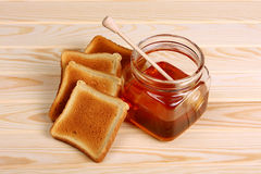 Croutons and jar of honey Stock Image