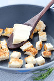 Croutons in a pan. Fried croutons in a pan with butter stock photo
