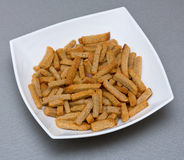 Croutons in plate. On grey background Stock Image