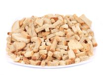 Croutons in a porcelain plate. Stock Image