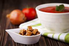 Croutons and red tomato soup Stock Photos