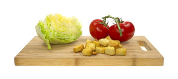Croutons Tomatoes And Lettuce On Cutting Board Royalty Free Stock Image