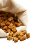 Croutons on white. Toasts have dropped out of a bag Royalty Free Stock Photography