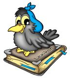 Crow on book. Grey crow siting on the book Stock Photo