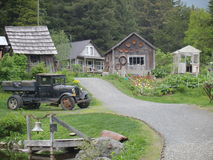 Crow Creek Mine. An old truck in front of some historic buildings at the Crow Creek Mine, Girdwood in Alaska stock photography