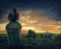 Crow on a gravestone. Crow sitting on a gravestone Royalty Free Stock Photography