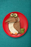 Crow made of bread, cheese and vegetables Royalty Free Stock Photo