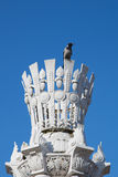 Crow sitting on architectural column Royalty Free Stock Image