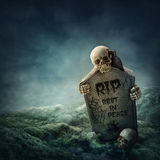 Crow sitting on a gravestone. At night Royalty Free Stock Photos