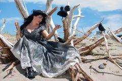 Crow whispering woman Stock Photo
