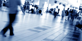 Crowd. People walking in the airport with motion blur royalty free stock photos