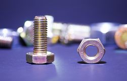 From the crowd. A nut and bolt in focus with more out of focus in the background Stock Photo