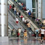 Crowd. Blurred crowd moving up an escalator Stock Image
