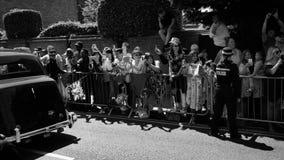 Crowd admiring the Rolls Royce in cortege. WINDSOR, UNITED KINGDOM - MAY 19, 2018: Crowd admiring the Rolls Royce in cortege of the newlywed carriage in Windsor stock video footage