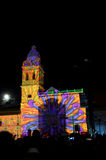 Crowd admiring the spectacle of lights projected on the facade of the Church of Santo Domingo, in the historical center of Quito. Stock Images