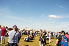Crowd on air show watching the sky to flying planescrowd on air show watching the sky to flying planes. Volkel, Netherlands - June 14, 2019: Crowd on air show royalty free stock images