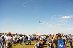 Crowd on air show watching the sky to flying planescrowd on air show watching the sky to flying planes. Volkel, Netherlands - June 14, 2019: Crowd on air show stock photo