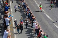 Crowd along the track of Marathon. Royalty Free Stock Photos