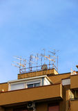 Crowd of antennas on the roof Royalty Free Stock Photos