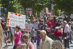 Crowd With Anti GMO and Monsanto Signs at Rally in Asheville, NC Stock Photo