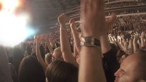 Crowd applauding in euphoria, clapping in tune with popular song during concert. Stock footage stock video