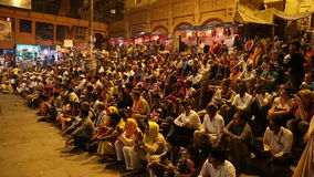 Crowd applauding at Ganga Aarti ritual in Varanasi. VARANASI, INDIA - 20 FEBRUARY 2015: Crowd applauding at Ganga Aarti ritual in Varanasi stock footage