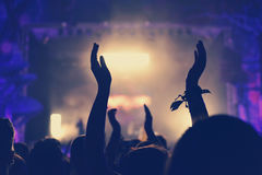 Crowd with arms outstretched at concert Stock Photo