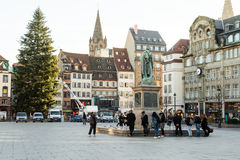 Crowd attending Place Kleber, Strasbourg. STRASBOURG, FRANCE - NOV 16, 2015: People looking at messages, candles and flowers are left around General Kleber Stock Photos